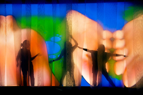 Figures Dancing behind Curtains with Projection by artist, Pipilotti Rist at Hayward Gallery
