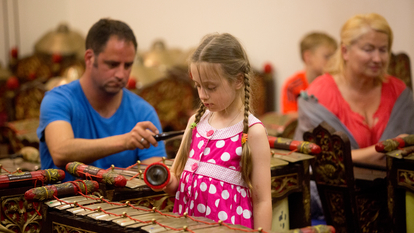 Girl playing the Gamelan