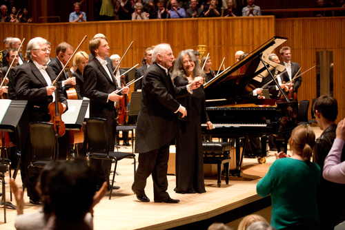 Martha Argerich and Daniel Barenboim taking a bow on stage at the Southbank Centre