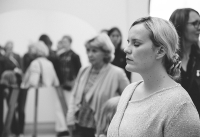 A Woman with her eyes closed at Surrounded by Strangers workshop