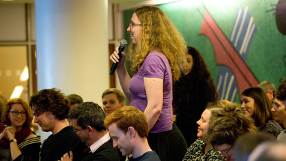Young Woman in Audience Speaking
