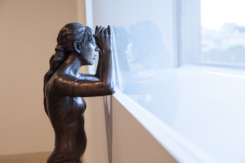 Bronze Figure Looking out of Window by artist, Ryan Gander at Hayward Gallery