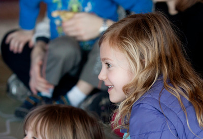 A young child watches a performance