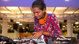 Female DJ playing at Alchemy Festival