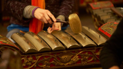Woman  playing the Gamelan