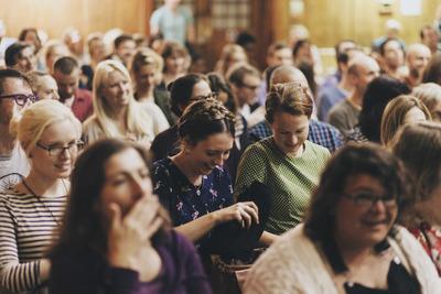 Audience Members Laughing