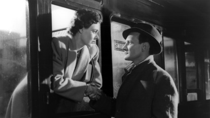 LAURA JESSON (CELIA JOHNSON) LEANS OUT OF THE TRAIN WINDOW AND SHAKES DR.ALEC HARVEY'S (TREVOR HOWARD) HAND. *** Local Caption *** Feature Film