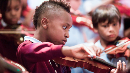 Young violinist at Lambeth Musitrax performance