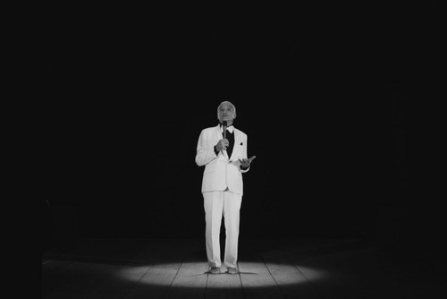 Poet, John Giorno performing 'THANX 4 NOTHING' on stage
