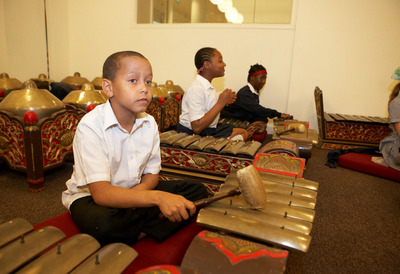 Boy playing the Gamelan