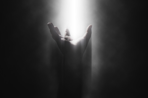 Image of beaming light on hand
