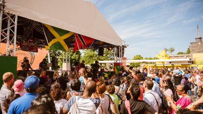 People dancing on Southbank Centre Riverside Terrace for Just Vibez Carnival as part of M.I.A.'s Meltdown festival