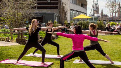 Women on the Queen Elizabeth Hall Roof Garden doing Yoga