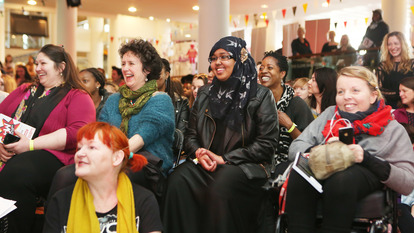 Female Audience Laughing at  Women of the World festival Think-In